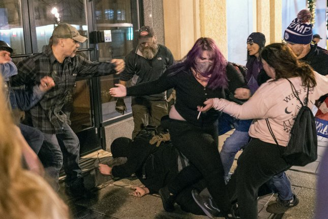 Proud Boys attack a few Antifa demonstrators on the sidewalk after a pro-Donald Trump rally in Washington on Saturday. Large groups of supporters marched on the nation's capital as they allege without evidence that President-elect Joe Biden stole the U.S. election. Photo by Ken Cedeno/UPI