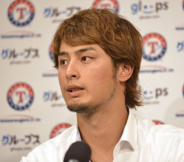 Texas Rangers pitcher Yu Darvish speaks at a news conference following the game against the Chicago White Sox at U.S. Cellular Field in Chicago, July 5, 2012. Darvish won the Final Vote by fans to fill the final spot on the 2012 American League All-Star team. UPI/Brian Kersey