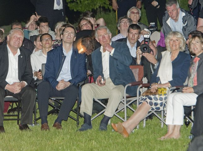 Prince Charles sits with his wife Camilla the Duchess of Cornwall, Ontario Premier Dalton McGuinty and Toronto Mayor Rob Ford (L) as they watch Victoria Day fireworks at Ashbridges Bay in Toronto, Ontario on May 21, 2012 after meeting members of the Ontario emergency services and their families during the second leg of their 2012 Royal Tour to Canada part of Queen Elizabeth's Diamond Jubilee celebrations. UPI Photo /Heinz Ruckemann