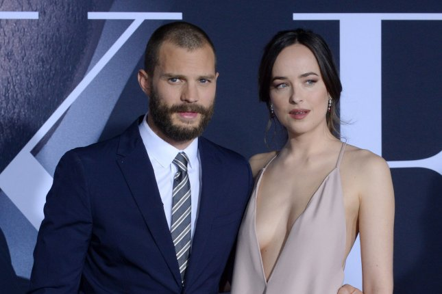 99a0c6f73a856 Cast members Jamie Dornan and Dakota Johnson attend the