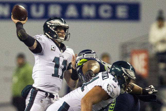 Philadelphia Eagles quarterback Carson Wentz (11) passes under pressure from Seattle Seahawks defensive tackle Jarran Reed (90) during the third quarter on December 3, 2017 at CenturyLink Field in Seattle. Photo by Jim Bryant/UPI