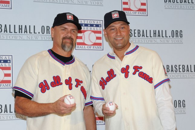 Former New York Yankees star Derek Jeter (R) and ex-Colorado Rockies slugger Larry Walker (L) were to be inducted with catcher Ted Simmons and the late Marvin Miller this July. File Photo by George Napolitano/UPI