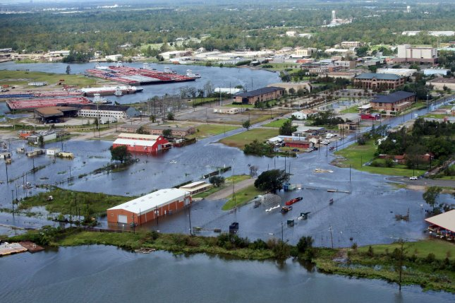 U.S. Coast Guard Air Station Clearwater, Fla.,  conducts an overflight to survey the damage after Hurricane Laura near Orange, Texas, on August 27. File Photo by PO3 Paige Hause/U.S. Coast Guard