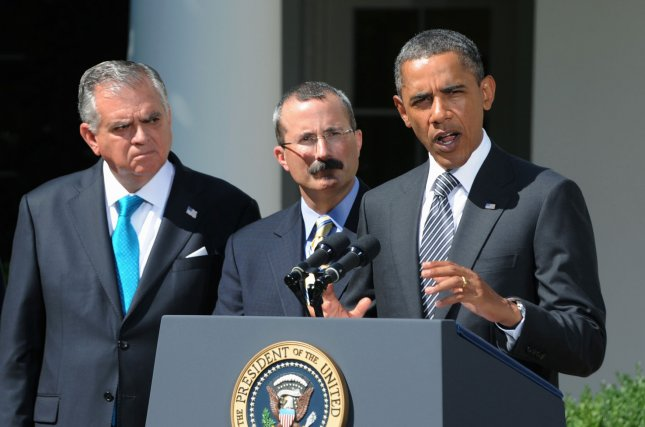 U.S. President Barack Obama makes a statement to urge Congress to pass an extension of a federal highway bill that would protect a million jobs, in the Rose Garden of the White House on August 31, 2011 in Washington, DC. Behind Obama is Transportation Secretary Ray La Hood (L) and U.S. Chamber of Commerce Chief Operating Officer David Chavern. UPI/Pat Benic..