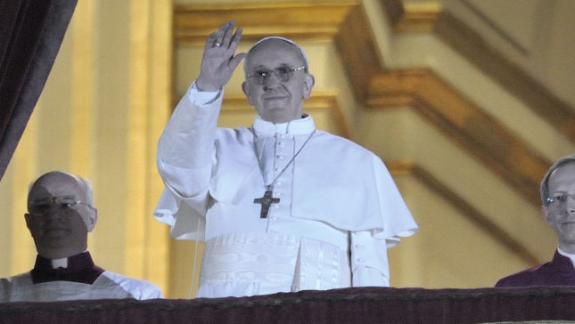 New pope pays hotel bill on first day