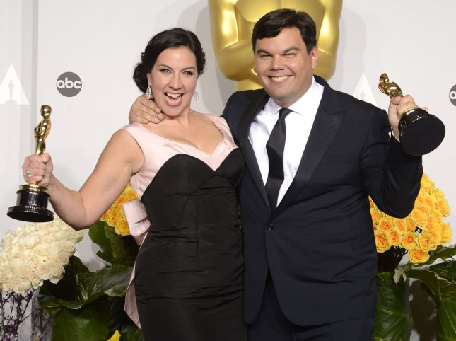 Songwriters Kristen Anderson-Lopez (L) and Robert Lopez hold their awards for Best Achievement in Music Written for Motion Pictures, Original Song 'Frozen' backstage during the 86th Academy Awards at the Hollywood & Highland Center on March 2, 2014 in the Hollywood section of Los Angeles. UPI/Phil McCarten