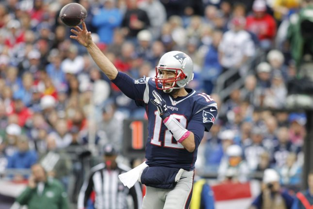 New England Patriots quarterback Tom Brady (12) drops back for a pass in the first quarter against the New York Jets at Gillette Stadium in Foxborough, Massachusetts on October 25, 2015. Photo by Matthew Healey/ UPI