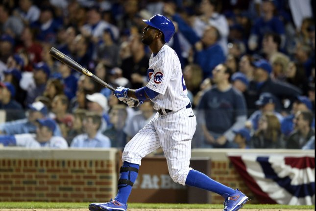 Chicago Cubs' Dexter Fowler follows through on a solo home run during the eighth inning of game 3 of the National League Division Series against the St. Louis Cardinals at Wrigley Field in Chicago on October 12, 2015. The Cubs defeated the Cardinals 8-6 and lead the best of five series 2-1. Photo by Brian Kersey/UPI