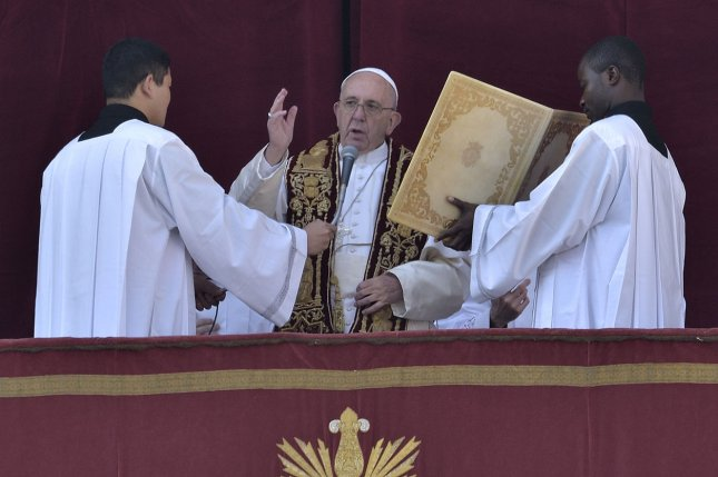 Pope Francis, pictured giving his Christmas message last year, condemned those who reject migrants who need assistance during his Sunday Easter address. File Photo by Stefano Spaziani/UPI