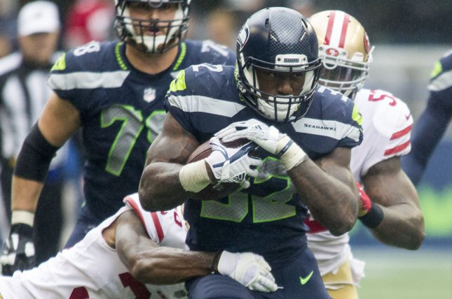 Seattle Seahawks running back Chris Carson (32) runs through the tackles of San Francisco 49ers cornerback Dontae Johnson (36) for a 16-yard gain on September 17, 2017 at CenturyLink Field in Seattle, Washington. Photo by Jim Bryant/UPI