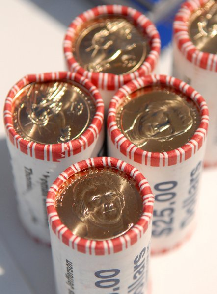 Rolls of the Thomas Jefferson one dollar coin are seen at a ceremony held by the U.S. Mint for the new coin in Washington on August 15, 2007. (UPI Photo/Kevin Dietsch)