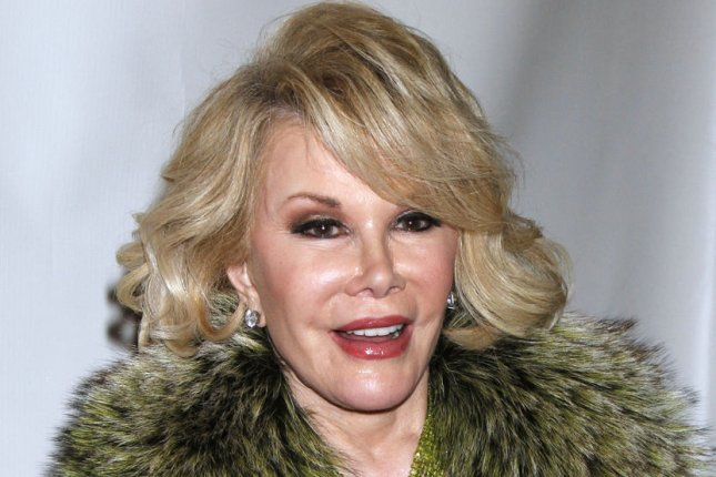 Joan Rivers arrives for the Friars Club Honors Larry King at a Testimonial Dinner Gala at the Sheraton Hotel in New York on November 14, 2011. UPI /Laura Cavanaugh