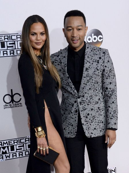 John Legend (R) and Chrissy Teigen at the 2016 American Music Awards on Sunday. File Photo by Jim Ruymen/UPI