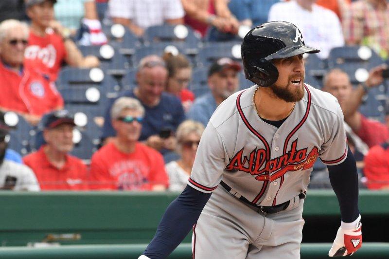 Atlanta Braves' Nick Markakis drops his bat as he hits a base hit. File photo by Pat Benic/UPI