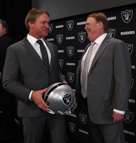 Oakland Raiders new head coach John Gruden chats with owner Mark Davis, left, at Raiders Headquarters in Alameda, Calif., earlier this month. Photo by Terry Schmitt/UPI