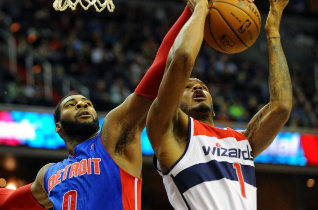 Washington Wizards small forward Trevor Ariza (1) is blocked by Detroit Pistons center Andre Drummond (0) in the first half on December 28, 2013 at the Verizon Center in Washington, D.C. File photo by Mark Goldman/UPI