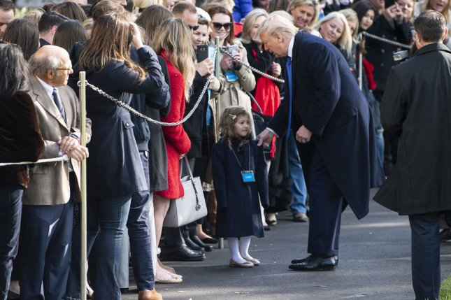 President Donald Trump greets a visitor to the White House Friday as he departs for a day trip to Atlanta, Ga. Photo by Kevin Dietsch/UPI