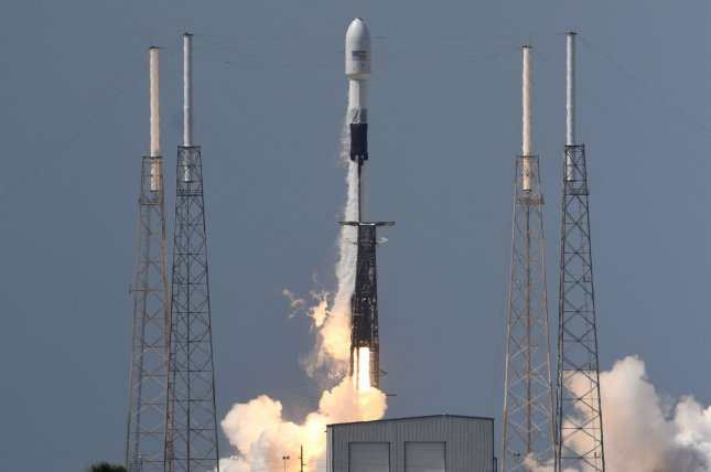 A SpaceX Falcon 9 rocket lifts off at 4:10 p.m. EDT Tuesday from Florida, carrying a new GPS III satellite for the U.S. Space Force. Photo by Joe Marino/UPI