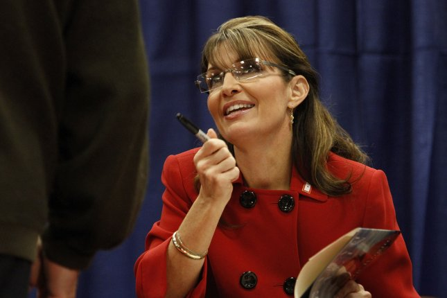 Former Alaska Gov. Sarah Palin talks with a customer at a signing for her new book Going Rogue: An American Life at the Woodland Mall Barnes & Noble in Grand Rapids, Mich., on November 18, 2009. On July 3, 2009, Palin announced she was resigning as governor of Alaska with 17 months to go in her term. File Photo by Brian Kersey/UPI