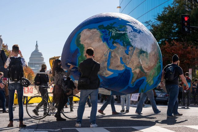 Protesters march the streets of Washington, D.C., to call attention to democracy and climate change awareness on November 4, 2020. They were protesting the Trump administration's withdrawal from the Paris climate agreement. File Photo by Ken Cedeno/UPI
