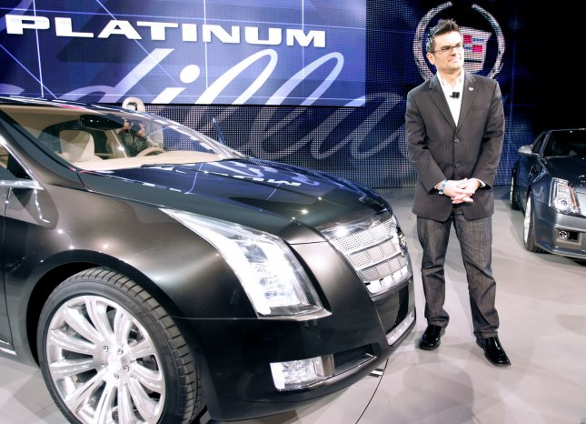 Bryan Nesbitt, general manager of Cadillac poses with the XTS Platinum concept car at the 2010 North American International Auto Show at the COBO Center in Detroit, MI., January 12, 2010. UPI/Mark Cowan