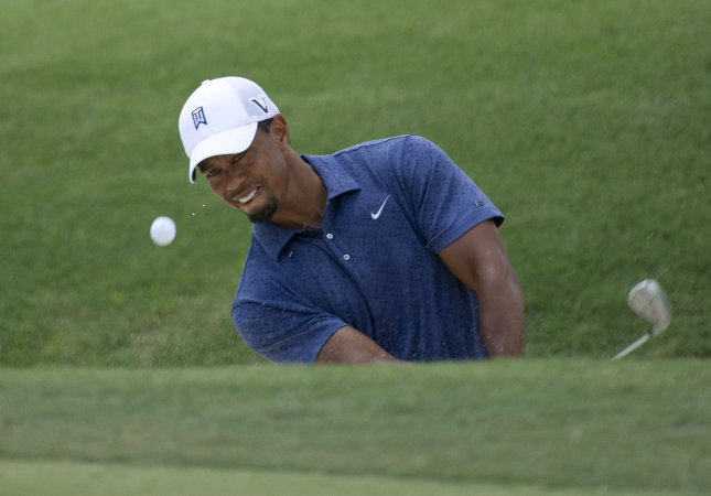 Tiger Woods, shown in an August 2011 file photo, is tied for the lead going into Sunday's final round of the European Tour's Abu Dhabi HSBC Golf Championship. UPI/Brian Kersey