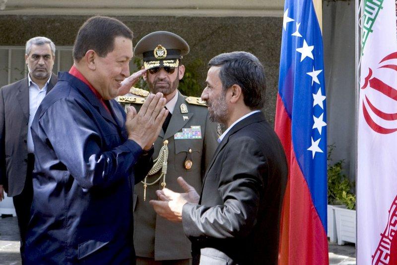 Iranian President Mahmoud Ahmadinejad (R) talks to Venezuelan President Hugo Chavez (L) during a welcoming ceremony for Chavez in Tehran, Oct. 19, 2010. UPI/Maryam Rahmanian