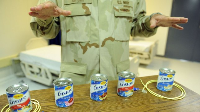 A Naval medical officer discusses how detainees on hunger strikes are cared for in the hospital at Camp Delta where detainees are housed at Naval Station Guantanamo Bay in Cuba on July 8, 2010. UPI/Roger L. Wollenberg