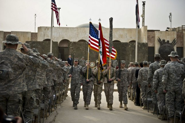 United States troops participate in a Dec. 15, 2011, ceremony in Baghdad marking the end of the U.S. military mission in Iraq. Cuomo/DoD/UPI/Erin A. Kirk/File