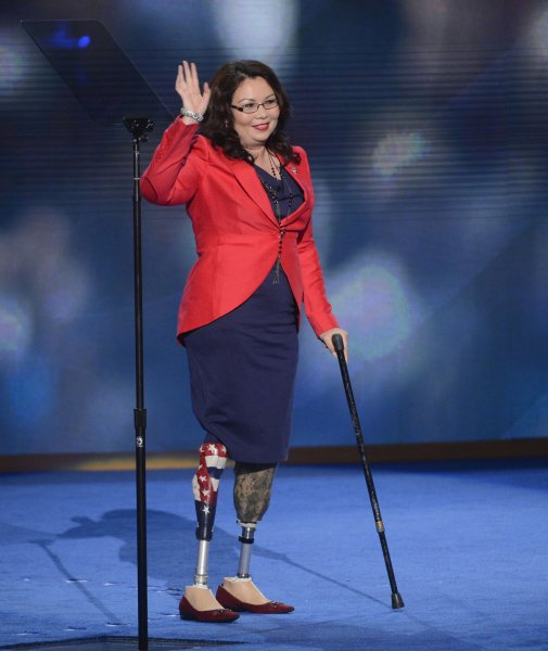 Tammy Duckworth, candidate for the House of Representatives from Illinois, departs after her speech at the Democratic National Convention at the Time Warner Cable Arena in Charlotte, North Carolina on September 4, 2012. Duckworth reached a $26,000 in a civil lawsuit alleging that she participated in workplace retaliation during her time as head of the Illinois Department of Veterans Affairs. The case had been a focal point of Republican Senator Mark Kirk's campaign against Duckworth as he seeks reelection. UPI/Kevin Dietsch