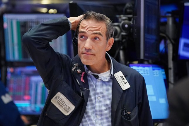 A trader on the the floor of the New York Stock Exchange reacts after the Dow lost several hundred points on August 23, as a direct result of the U.S.-China trade impasse. File Photo by John Angelillo/UPI