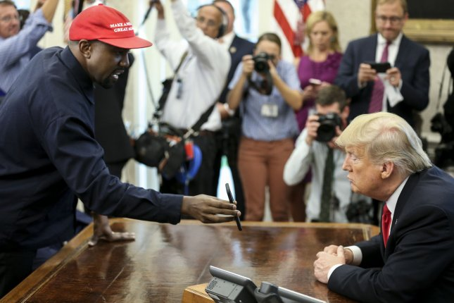 Kanye West and President Donald Trump meet in the Oval Office in 2018. West has announced he will run against Trump in the upcoming election. File Photo by Oliver Contreras/UPI