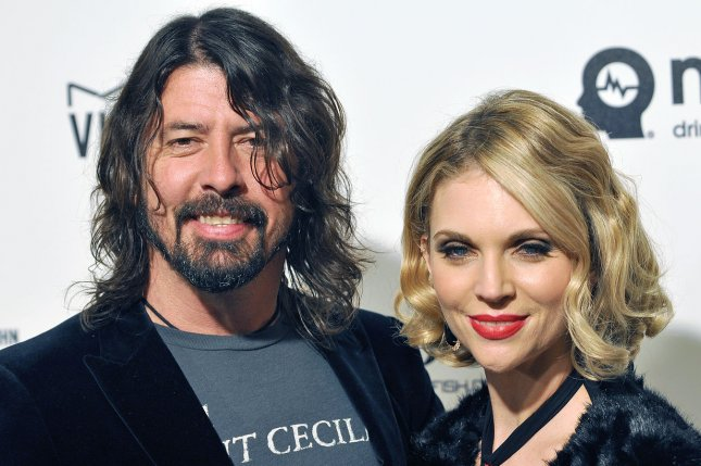 Foo Fighters frontman Dave Grohl (L) and his wife, Jordyn Blum, arrive at the Elton John Aids Foundation's 24th Annual Academy Awards viewing party in February 2016. Grohl's Paramount+ series will be released on May 6. File Photo by Christine Chew/UPI