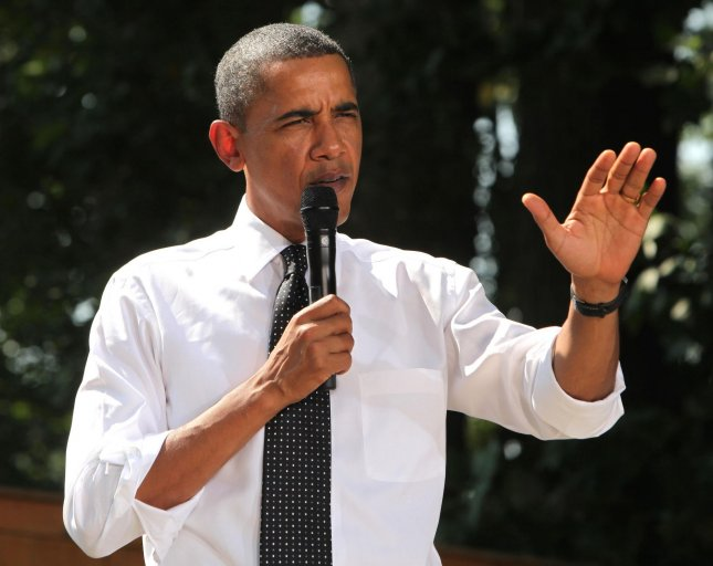US President Barack Obama answers questions about the health care plan with a group in the backyard of the home of Paul and Frances Brayshaw in Falls Church, Virginia, on September 22, 2010. UPI/Dennis Brack/POOL