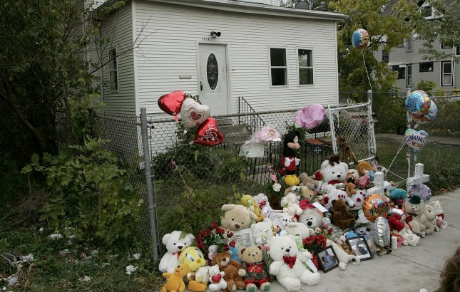 A makeshift memorial left by neighbors and friends stands in front of the childhood home of Oscar-winning actress Jennifer Hudson on October 27, 2008. A body found in an SUV on Chicago's west side early Monday morning is believed to be that of Jennifer Hudson's missing 7-year-old nephew Julian King, the focus of a desperate search since the Oscar winner's mother Darnell Donerson, 57, and 29-year old brother Jason Hudson were found shot to death in their home three days earlier. (UPI Photo/Brian Kersey)
