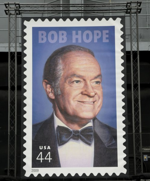 U.S. Postal Service officials and family members unveil a 44-cent postage stamp honoring comedian Bob Hope during a ceremony held aboard the retired aircraft carrier U.S.S. Midway on May 29, 2009 in San Diego. (UPI Photo/Earl S. Cryer)