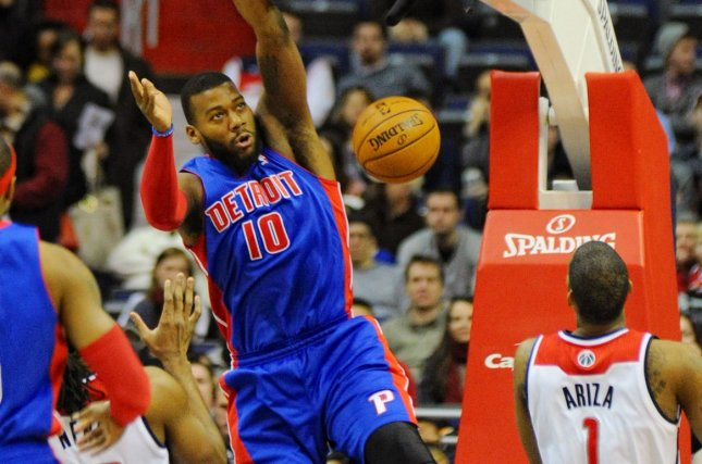 Detroit Pistons power forward Greg Monroe (10) dunks the ball for two points against Washington Wizards power forward Nene Hilario (42) in the first half at the Verizon Center in Washington, D.C. on January 18, 2014. UPI/Mark Goldman
