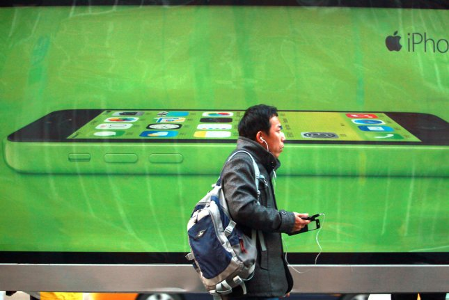 Apple's new iPhone 5C is promoted on the streets of Beijing on December 8, 2013. A manufacturing base in Zhengzhou, China is a major supplier of iPhone production. UPI/Stephen Shaver