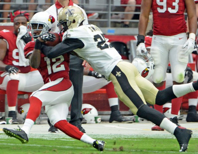 New Orleans Saints Damian Swann hits John Brown in the first quarter the Cardinals-Saints game at University of Phoenix Stadium in Glendale, Arizona, September 13, 2015. Photo by Art Foxall/UPI