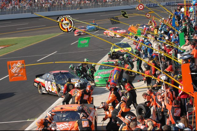 Cars stream into the pits at Talladega Superspeedway, in Talladega, Al. (UPI Photo/John Dickerson)..