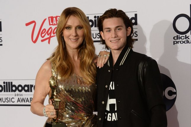 Singer Celine Dion and her son Rene-Charles Angelil appear backstage with her Icon Award during the annual Billboard Music Awards on May 22, 2016. Photo by Jim Ruymen/UPI