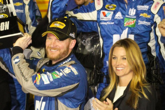 Dale Earnhardt, Jr. (L) celebrates with Amy Reimann after winning a Can-Am qualifying race on February 18, 2016. The stock car racing pro announced Reimann's pregnancy in a post Monday. File Photo by Mike Gentry/UPI