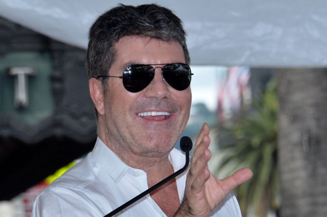 Simon Cowell was treated at a hospital Friday after falling down the stairs at his house in London. File Photo by Jim Ruymen/UPI