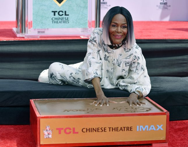 Screen legend Cicely Tyson is honored with a handprint and footprint ceremony at the TCL Chinese Theatre in Hollywood during the 9th annual TCM Classic Film Festival on Friday. Photo by Chris Chew/UPI