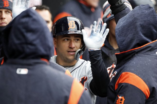 Detroit Tigers shortstop Jose Iglesias celebrates with teammates after scoring against the Chicago White Sox in the fourth inning on April 5 at Guaranteed Rate Field in Chicago. Photo by Kamil Krzaczynski/UPI