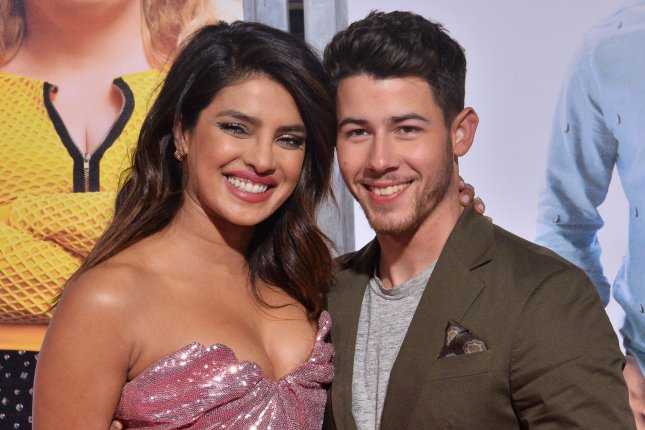 Nick Jonas, of The Jonas Brothers (R), and his wife Priyanka Chopra. The Jonas Brothers party in Miami in their new music video for Cool. File Photo by Jim Ruymen/UPI