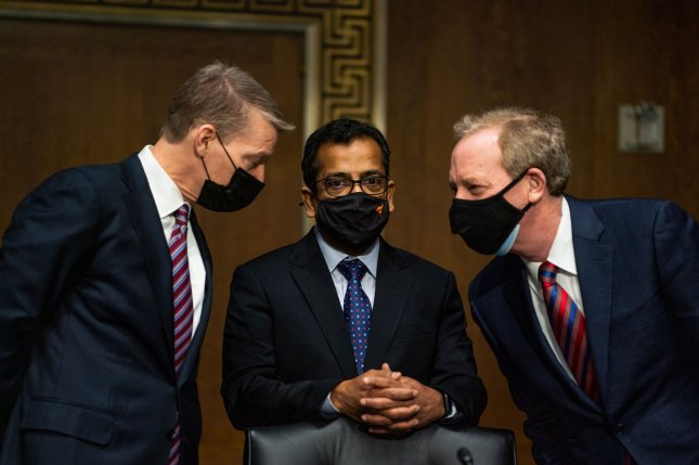 FireEye CEO Kevin Mandia (L), SolarWinds CEO Sudhakar Ramakrishna (C) and Microsoft President Brad Smith speak with each other before the start of a Senate intelligence committee hearing on a March breach of SolarWinds' software. Pool Photo by Drew Angerer/UPI
