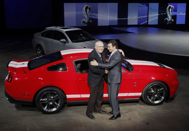 Mark Fields (R), executive vice president and president, the Americas, Ford Motor Company, hugs race car designer Carroll Shelby as they introduce the 2010 Shelby GT500 at the North American International Auto Show at the Cobo Center on January 11, 2009 in Detroit, Michigan. (UPI Photo/Brian Kersey)