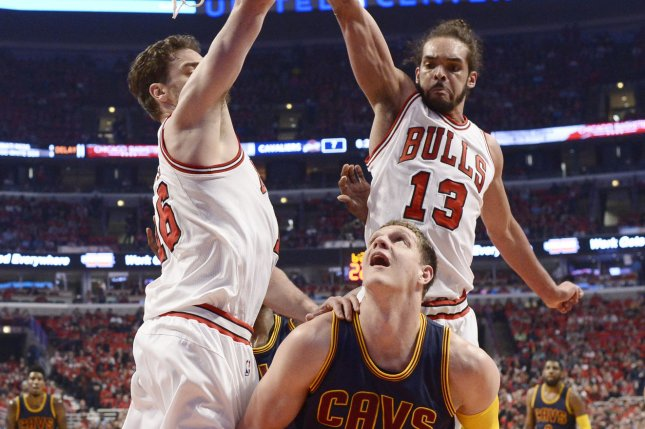 Cleveland Cavaliers center Timofey Mozgov (C) goes up for a shot as Chicago Bulls forward Pau Gasol (L) and center Joakim Noah defend during the first quarter of game 3 the Eastern Conference Semifinals of the NBA Playoffs at the United Center on May 8, 2015 in Chicago. Photo by Brian Kersey/UPI