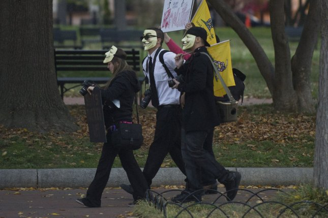 Protesters walk through Lafayette Park following the Million Mask March 2013 in Washington D.C. Anonymous will announce the full list of names and numbers at the annual event held on Guy Fawkes Day on Nov. 5, 2015. Photo by Kevin Dietsch/UPI